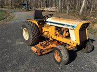 International Cub Lo Boy Tractor with 59 inch Woods belly mower and Hydraulic lift.