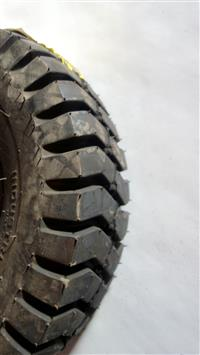 TI-144 | TI-144  Specialty Tire of America 6.90-9NHS Forklift Tire with Tire Flap (NOS) (1).JPG
