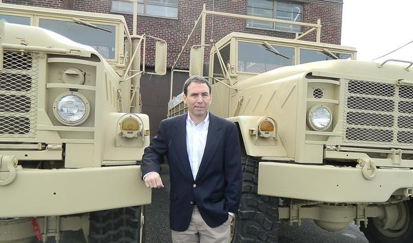 David Newman of Eastern Surplus with one of the military vehicles he sells